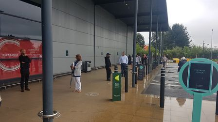 Shoppers have gathered in the rain as John Lewis reopens its doors Picture: WILL JEFFORD