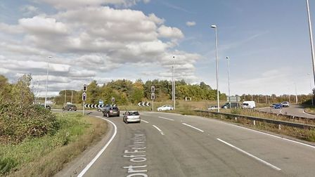 Police remain at the scene of a crash between a Citroen C4 and a Peugeot 206 on the Dock Spur Rounda