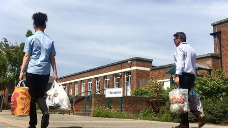 Alicia with donations to the foodbank at Northgate High School, in Ipswich. Picture: NORTHGATE HIGH