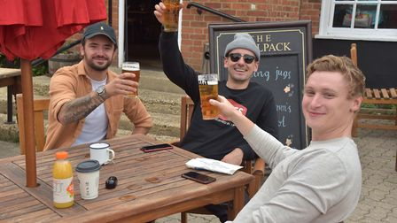 Drinkers raise their pints at The Woolpack in Ipswich Picture: Sonya Duncan
