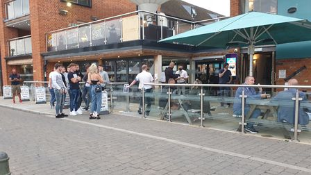 A queue formed outside Isaacs later in the evening as people enjoyed the the pub's reopening Picture