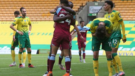 The Norwich players look dejected as Michail Antonio of West Ham United celebrates scoring his side