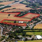 The field outlined in red is most of the development site - the field runs right along Howlett Way a