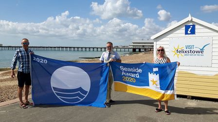 Mayor of Felixstowe, Mark Jepson and town councillor Seamus Bennett, holding up the flags, assisted