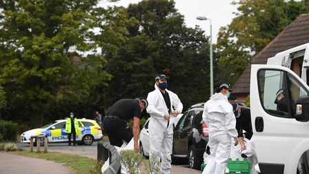 Suffolk Police officers put on forensic suits near to the scene on Friends Walk, Kesgrave Picture: