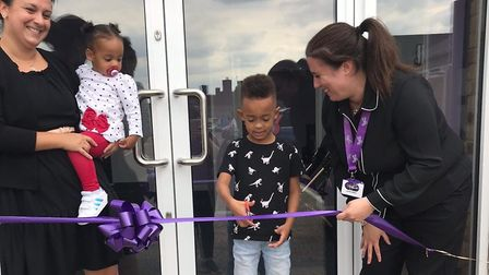 Nursery manager Laura Sines cut the ribbon to open the Twizzle Tops Ipswich nursery with their first