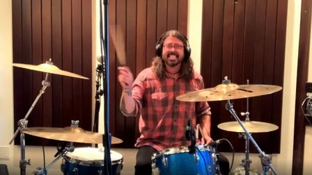 Rock star Dave Grohl challenges Nandi Bushell of Ipswich to learn one his druim parts in their onlin