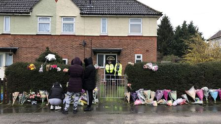Tributes were left outside the mother and son's home at Swinburne Road, Ipswich, last March Picture: