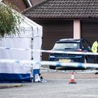 A white police forensics tent can also still be seen. Picture: SARAH LUCY BROWN