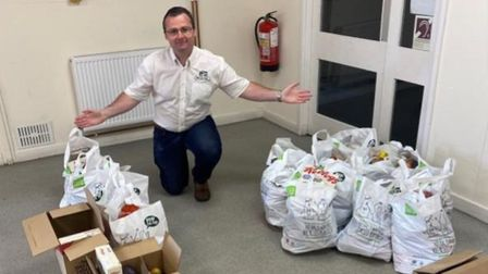 Castle Hill Community Centre manager Garath Jones with some of the Community Pantry's food deliverie