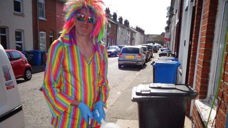 Ipswich's rainbow postman Stewart Lennox has turned his attention to cleaning the town's streets Pi