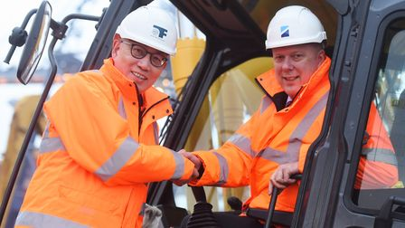 Port of Felixstowe CEO Clemence Cheng shaking hands with former transport secretary Chris Grayling i