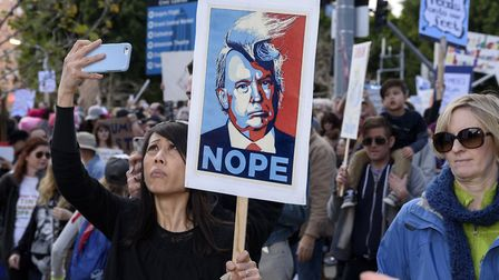 Campaigners across the world have been protesting against Donald Trump. Image: Ronen Tivony/PA.