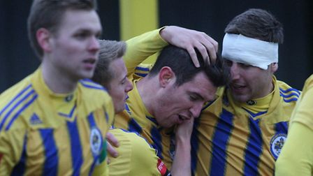 Romford players celebrate one of their goals against Ware (George Phillipou/TGS)