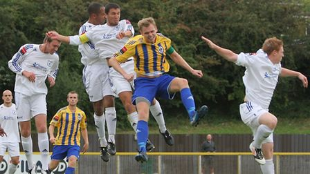 Jack Barry of Romford is thwarted by a packed Wroxham defence at Ship Lane in September (Gavin Ellis