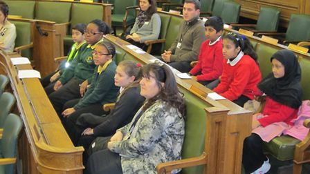 Pupils from the E13 Learning Community in council chambers at Newham Town Hall.
