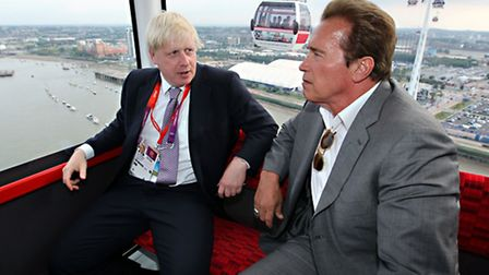 Mayor Boris Johnson (left) and Arnold Schwarzenegger take a ride on the Emirates cable car from Gree