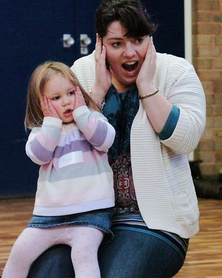 Parents and children act with surprise during the interactive sessions