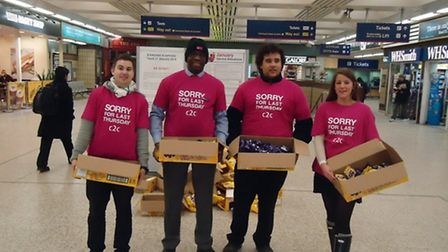 National Express train operator c2c gives away 20,000 chocolates to commuters as an apology for poor