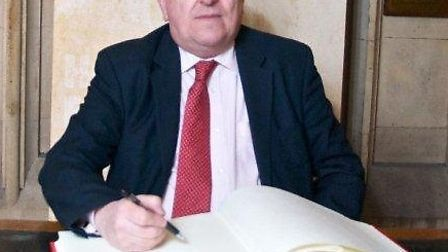 Ilford South MP Mike Gapes signs the Book of Commitment to mark Holocaust Memorial Day