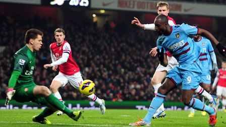 West Ham United's Carlton Cole (right) has a shot on goal during the Barclays Premier League match a