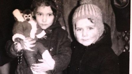 Sharon Fray (née Heyburn) aged five, and brother Sean, aged three, with the monkeys, Christmas 1969