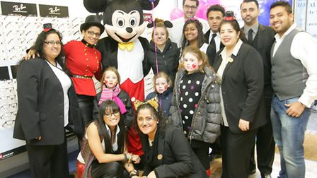 Mickey Mouse with staff and visitors at the Boots opticians