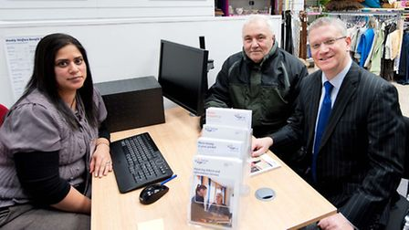 Romford MP Andrew Rosindell (R) with service user Bob Wood (centre) and advisory services manager Pr