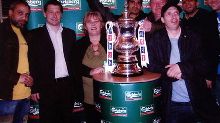 Shirley McCarron, next to former West Ham player Tony Cottee, with the Carling Cup during a fund rai