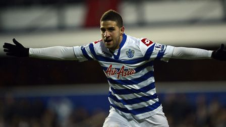 QPR's Adel Taarabt celebrates scoring the first goal during the Barclays Premier League match at Lof