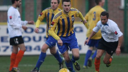 Romford's Paul Clayton goes on the attack against Ware (George Phillipou/TGS)