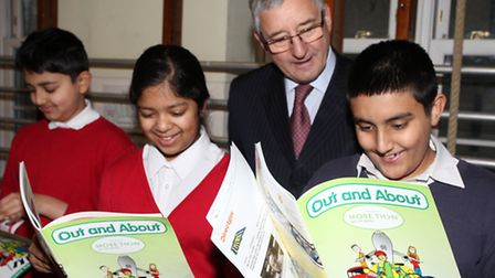 MP Jim Fitzpatrick presents a set of road safety learning resources to pupils at Mayflower Primary S