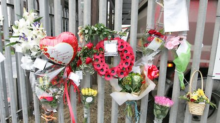 TRIBUTES: Family and friends leave messages of tribute at the scene of the accident