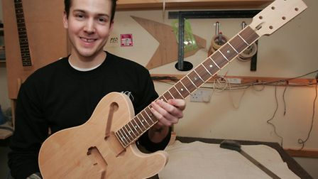 Leigh Dovey runs a custom guitar company from a small workshop in Woodford Green
