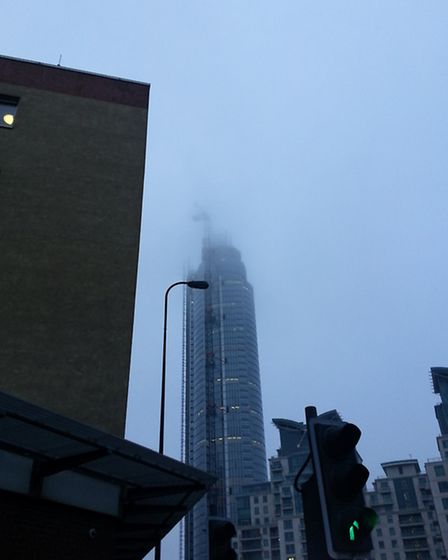 The crane on top of a residential tower at One St George Wharf was shrouded in fog. Photo: Raj Tailo