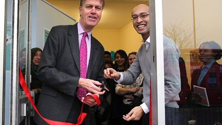 MP Stephen Timms Faisel Rahman at the store opening. Picture: Ron Lamb