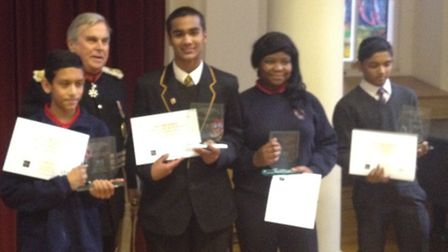 Lord Lieutenant Sir David Brewer presenting team Newham with their certificates.