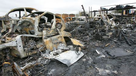 Burnt-out cars are all that remain in the Dogwood yard (photo: Steve Poston)