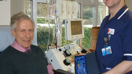 Robin Greatorex collecting his award for his 100th blood donation