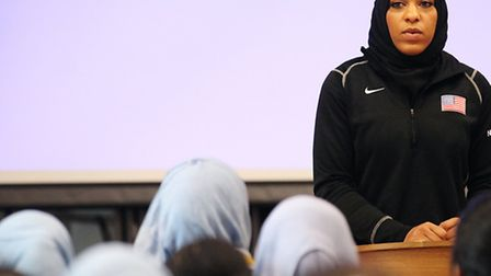 American sabre fencer Ibtihaj Muhammad gives a talk about her sporting career to the student girls a
