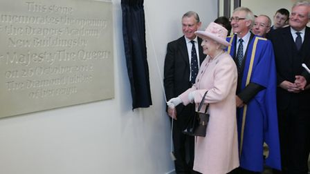 The Queen unveils the plaque marking her visit at Drapers' Academy. Picture: Paul Bennett