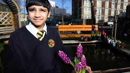 Karanveer Singh, 12, posing proudly with a homegrown plant. Picture: Ron Lamb