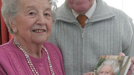 Jessie and John Pask with their 'blue sapphire' anniversary card from the Queen