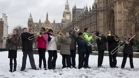Children various schools from Newham East London, warm up their instruments outside the Palace of We