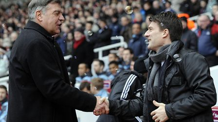 Swansea City manager Michael Laudrup (right) is greeted by West Ham United manager Sam Allardyce bef