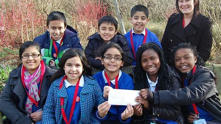 Kids from John Heron Primary drop in at Beckton House Hospice to hand over their cheque