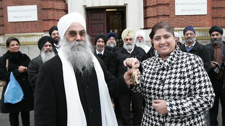 Amrit Panesar hands the keys to Ilford County Court to head priest Sant Partap Singh,