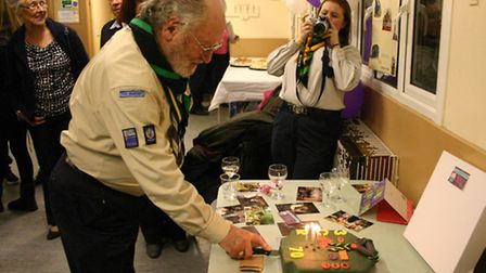 Alf Reeve cuts the birthday cake for the 3rd Collier Row Scouts Group 70th Anniversary