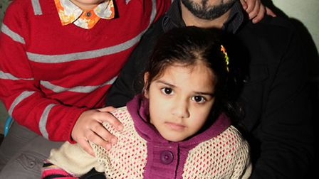 Father Bilal Ahmed with Mugtabaa Mohammed Ahmed, seven, and Bakhtawar Bilal, four.