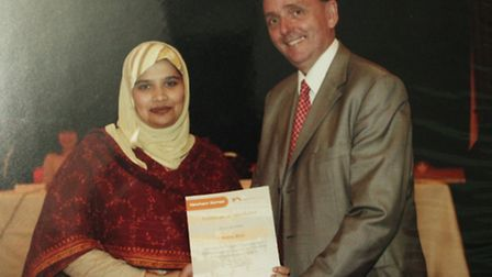 Sobia Bilal receiving a certificate from Newham Mayor Sir Robin Wales for completing a council cours